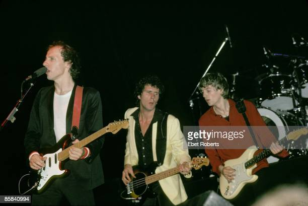 UNITED STATES JANUARY 01 Photo of John ILLSLEY and DIRE STRAITS and Mark KNOPFLER and Hal LINDES LR Mark Knopfler John Illsley Hal Lindes performing...