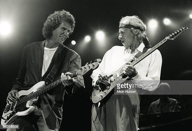 ARENA Photo of John ILLSLEY and DIRE STRAITS and Mark KNOPFLER John Illsley and Mark Knopfler performing live onstage