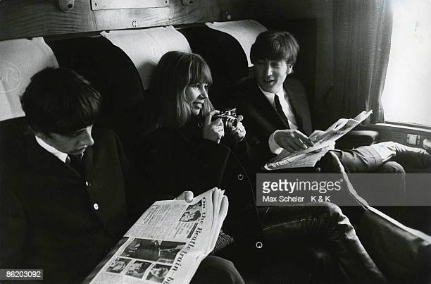 Photo of John LENNON and Astrid KIRCHHERR and BEATLES LR Ringo Starr Astrid Kirchherr John Lennon sitting on train during the filming of A Hard Day's...