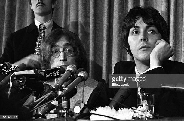 Photo of John LENNON and BEATLES and Paul McCARTNEY John Lennon Paul McCartney at the press conference to launch Apple