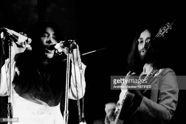 LYCEUM Photo of John LENNON and Yoko ONO Yoko Ona and John Lennon performing on stage with the Plastic Ono Band at UN Childrens Fund concert