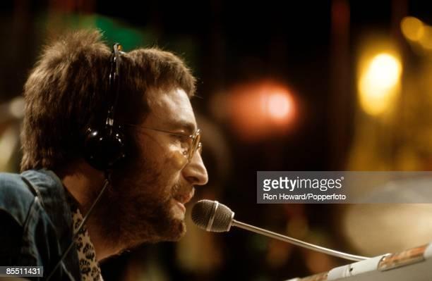 POPS Photo of John LENNON Performing Instant Karma wearing headphones