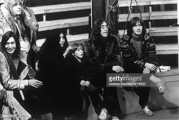Photo of John LENNON posed on the set of The Rolling Stones' 'Rock 'n' Roll Circus' with Charlie Watts Brian Jones Yoko Ono Julian Lennon Eric Clapton