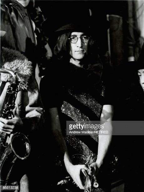 Photo of John LENNON while in The Beatles posed on the set of 'Rock 'n' Roll Circus'