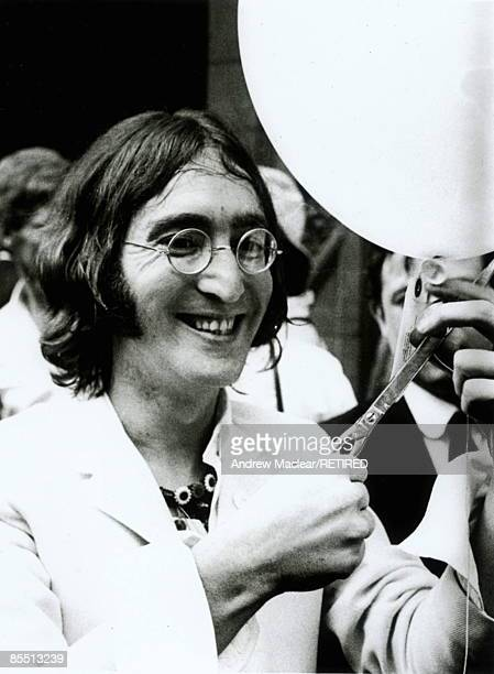 Photo of John LENNON while in The Beatles posed with balloon at the opening of his You Are Here exhibition at the Robert Fraser Gallery Mayfair