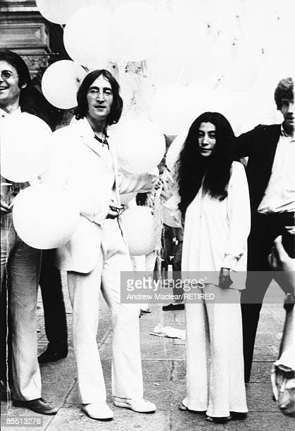 Photo of John LENNON while in The Beatles posed with Yoko Ono at the opening of John's You Are Here exhibition at the Robert Fraser Gallery Mayfair