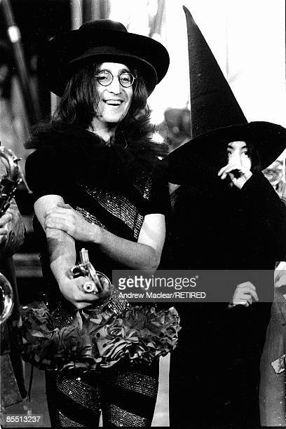 Photo of John LENNON with Yoko Ono posed on the set of The Rolling Stones' 'Rock 'n' Roll Circus'
