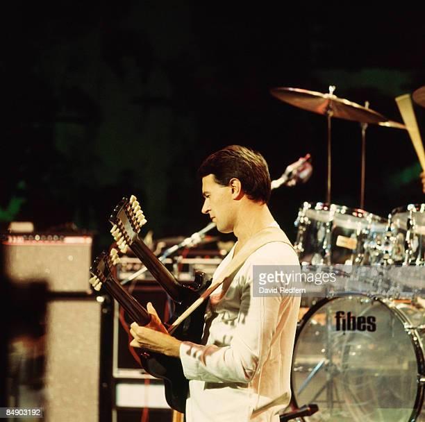 Photo of John McLAUGHLIN and MAHAVISHNU ORCHESTRA, John McLaughlin performing on stage, twin necked guitar