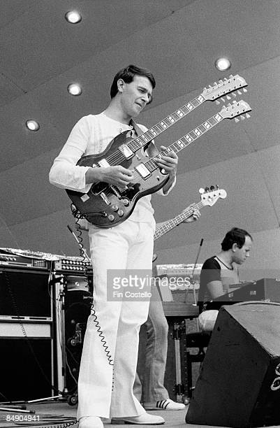 Photo of John McLAUGHLIN and MAHAVISHNU ORCHESTRA, John McLaughlin performing on stage, Gibson EDS-1275 twin necked guitar