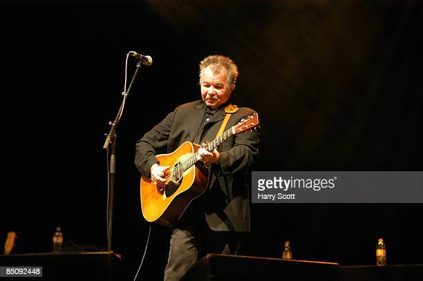 PALLADIUM Photo of John PRINE John Prine performing on stage acoustic guitar