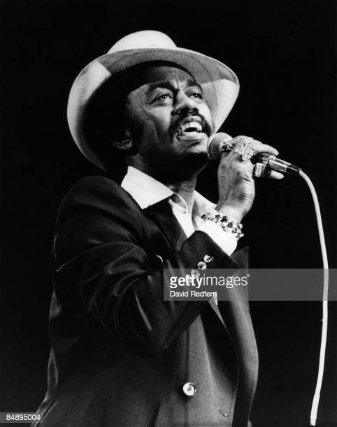 Photo of Johnnie TAYLOR Johnnie Taylor performing on stage wearing hat
