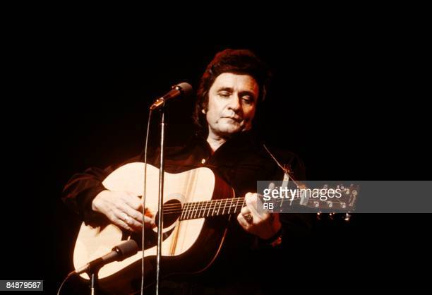 Photo of Johnny CASH and Johnny CASH Johnny Cash performing on stage