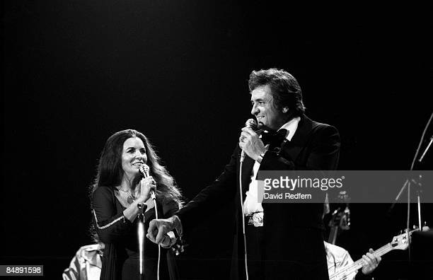 WEMBLEY Photo of Johnny CASH and June CARTER June Carter and Johnny Cash performing on stage