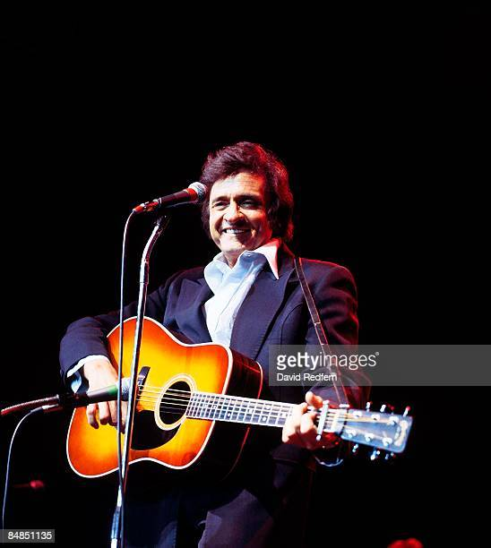 ARENA Photo of Johnny CASH Johnny Cash performing on stage at Festival of Country Music playing Martin acoustic guitar
