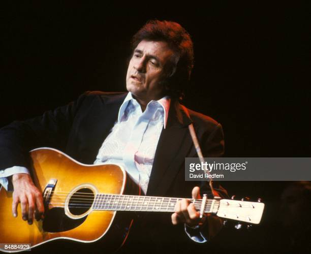 ARENA Photo of Johnny CASH Johnny Cash performing on stage at the Festival of Country Music playing Martin acoustic guitar