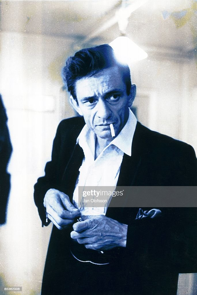 ODEON Photo of Johnny CASH, Portrait of Johnny Cash smoking cigarette