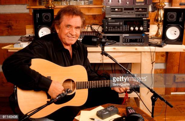 NASHVILLE Photo of Johnny CASH Posed portrait of Johnny Cash with Takamine acoustic guitar recording in home studio