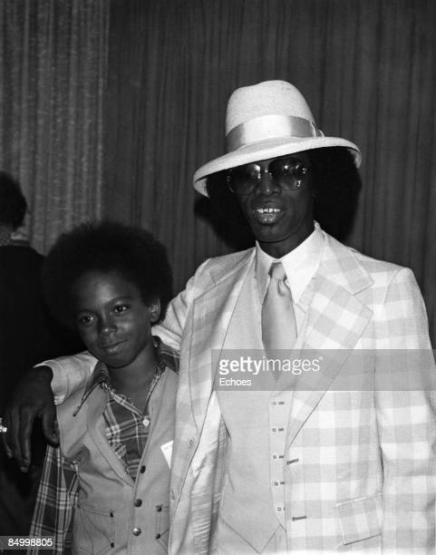 Photo of Johnny Guitar WATSON Portrait of Johnny 'Guitar' Watson with a young boy