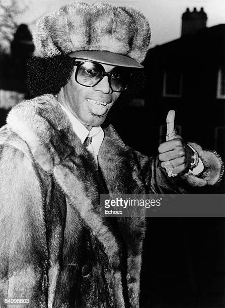 Photo of Johnny Guitar WATSON Posed portrait of Johnny 'Guitar' Watson wearing fur hat coat and susnglasses