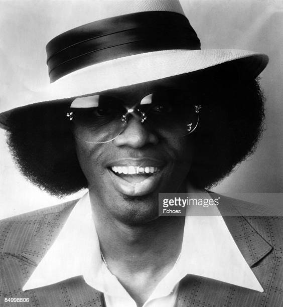 Photo of Johnny Guitar WATSON Posed studio portrait of Johnny 'Guitar' Watson wearing sunglasses