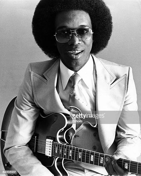 Photo of Johnny Guitar WATSON Posed studio portrait of Johnny 'Guitar' Watson with a guitar wearing sunglasses