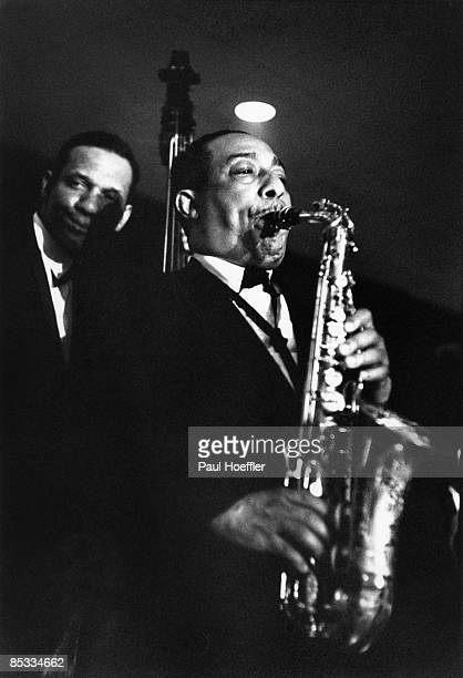 Photo of Johnny HODGES Johnny Hodges performing on stage playing saxophone