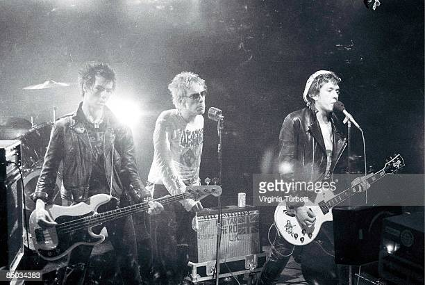 Photo of Johnny ROTTEN and SEX PISTOLS and Sid VICIOUS and Steve JONES LR Sid Vicious Johnny Rotten Steve Jones performing on set of 'Pretty Vacant'...
