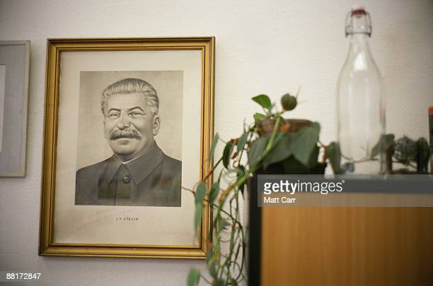photo of joseph stalin hanging in home - dictator stock pictures, royalty-free photos & images