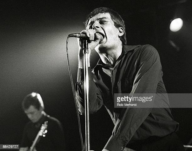 ROTTERDAM Photo of Joy Division Ian Curtis and Bernard Sumner performing live onstage at the Lantaren