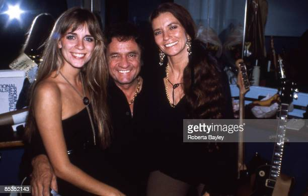 Photo of June CARTER and Carlene CARTER and Johnny CASH; Johnny Cash with step daughter Carlene Carter and wife June Carter Cash