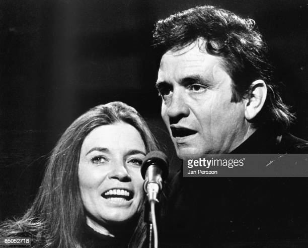 Photo of June CARTER and Johnny CASH; Johnny Cash and wife June Carter Cash performing on stage for tv show