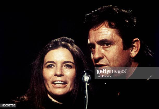 Photo of June CARTER and Johnny CASH Johnny Cash and wife June Carter Cash performing on stage for tv show