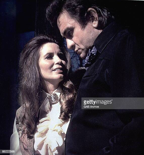 USA Photo of June CARTER and Johnny CASH Johnny Cash and wife June Carter Cash performing on stage