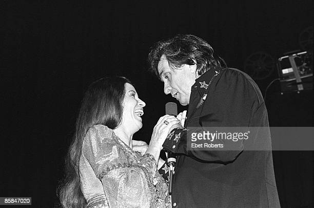 UNITED STATES JANUARY 01 Photo of June CARTER and Johnny CASH Johnny Cash and wife June Carter Cash performing on stage