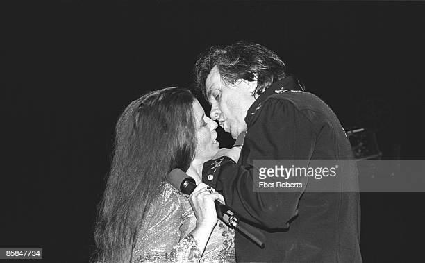 Photo of June CARTER and Johnny CASH Johnny Cash kissing wife June Carter Cash