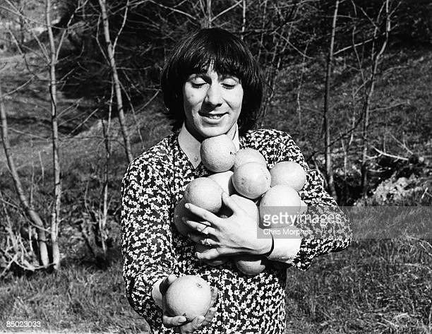 Photo of Keith MOON and The Who Keith Moon posed holding fruit on the German Tour