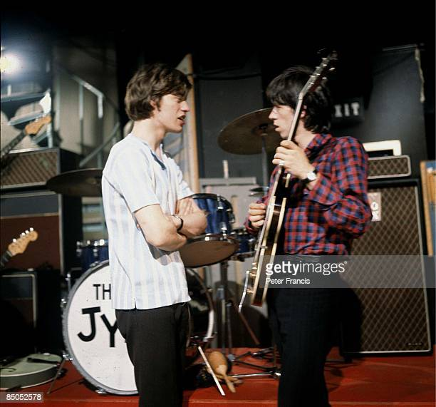 Photo of Keith RICHARDS and Mick JAGGER and ROLLING STONES, Mick Jagger and Keith Richards talking on the set of Ready Steady Go! TV Show at...