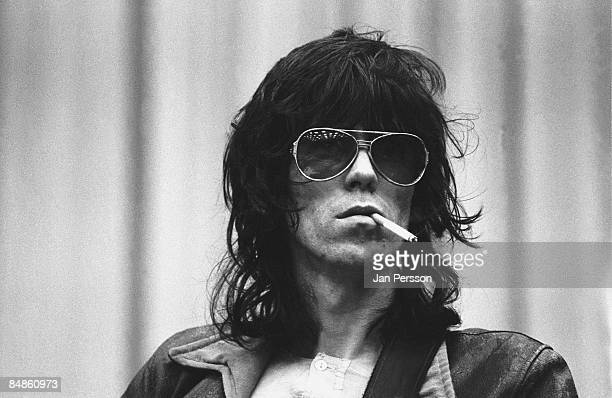Photo of Keith RICHARDS and ROLLING STONES Keith Richards onstage during soundcheck wearing sunglasses smoking cigarette