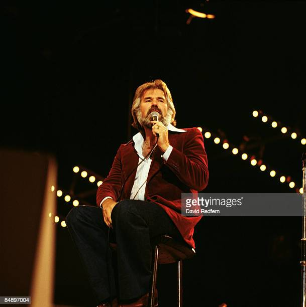 POOL Photo of Kenny ROGERS Kenny Rogers performing on stage