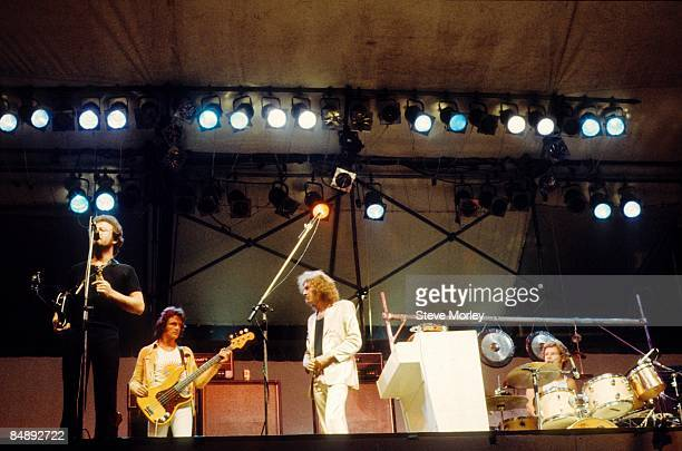 PARK Photo of KING CRIMSON and Robert FRIPP and John WETTON LR Robert Fripp John Wetton and Bill Bruford performing on stage