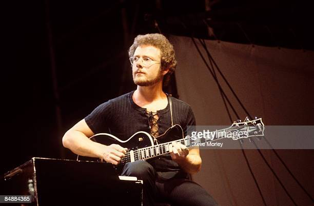 Photo of KING CRIMSON and Robert FRIPP Robert Fripp performing live on stage playing Gibson Les Paul guitar