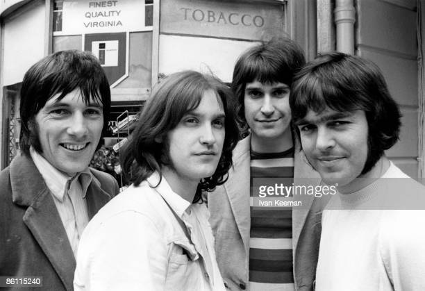 Photo of KINKS and Mick AVORY and Dave DAVIES and Ray DAVIES and John DALTON Posed group portrait in the street LR Mick Avory Dave Davies Ray Davies...