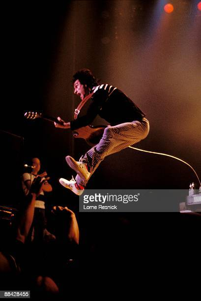 USA Photo of KINKS and Ray DAVIES Ray Davies performing live onstage jumping in the air leaping across stage