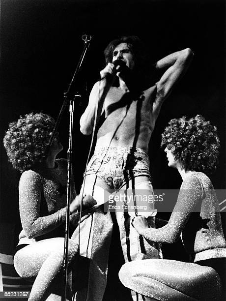 Photo of KINKS and Ray DAVIES Ray Davies performing on stage undressing underwear