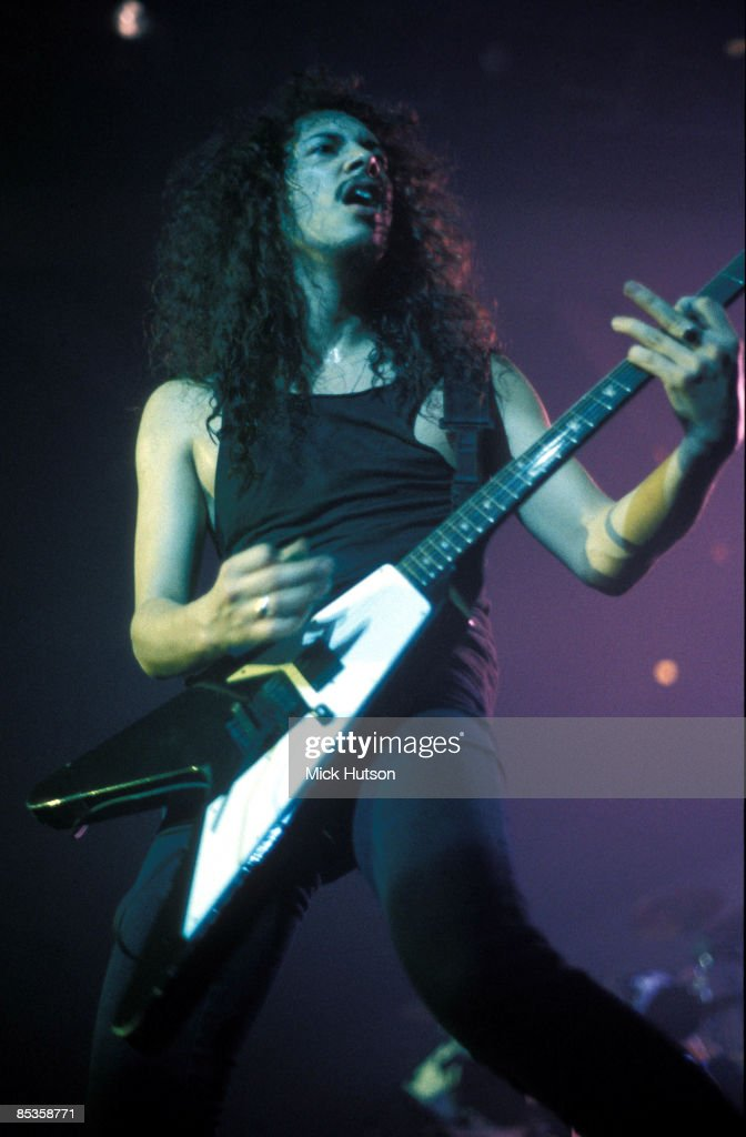 ARENA Photo of Kirk HAMMETT and METALLICA, Kirk Hammett performing live on stage, playing Gibson Flying V guitar