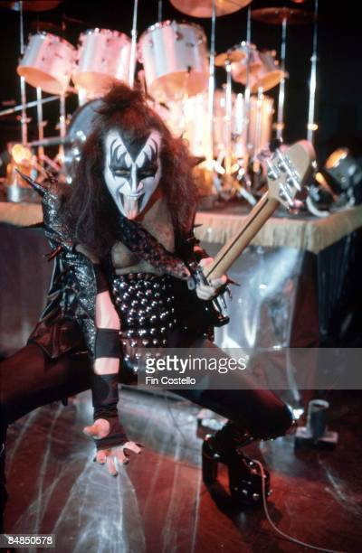 HALL Photo of KISS and Gene SIMMONS Gene Simmons performing live onstage during cover session for Alive album looking to camera sticking out tongue