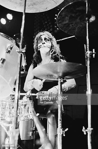 Photo of KISS and Peter CRISS, Peter Criss performing live onstage during cover session for Alive! album