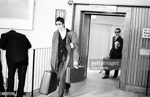Photo of Kit LAMBERT and Pete TOWNSHEND and The Who Pete Townshend and Kit Lambert returning from an Italian tour through Heathrow Airport carrying...