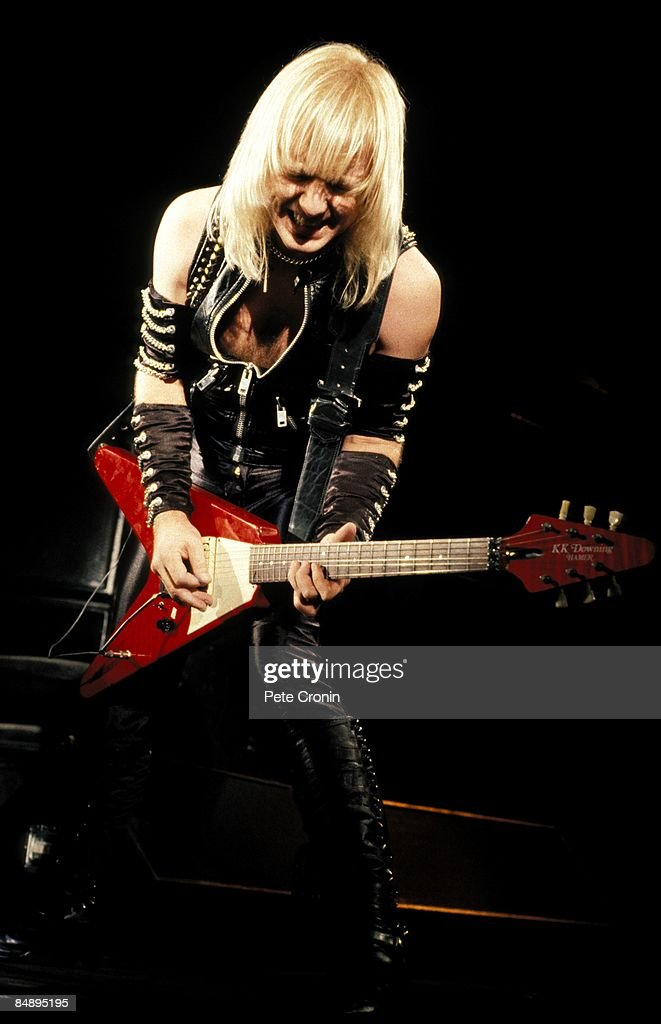 Photo of KK DOWNING and JUDAS PRIEST; KK Downing performing live onstage, playing Hamer KK Downing Flying V guitar,