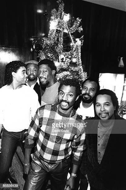 Photo of KOOL THE GANG Posed group portrait Christmas tree